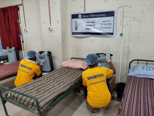 Sewa International, Volunteers are Seen Setting up Oxygen Concentrators in a COVID-19 Care Center in India